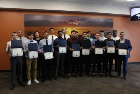 Varsity basketball boys recognized by City Hall for memorial clean-up