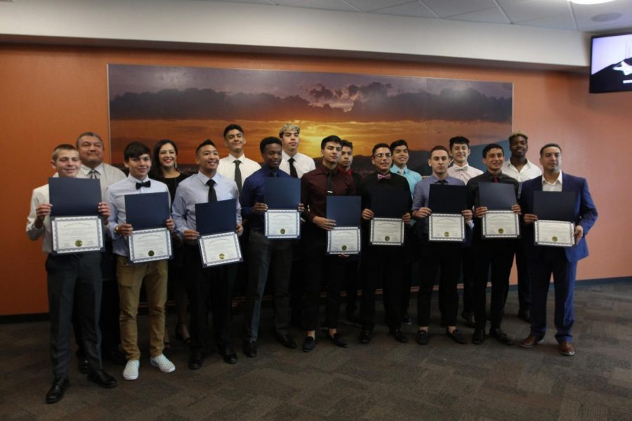 Varsity+basketball+boys+recognized+by+City+Hall+for+memorial+clean-up