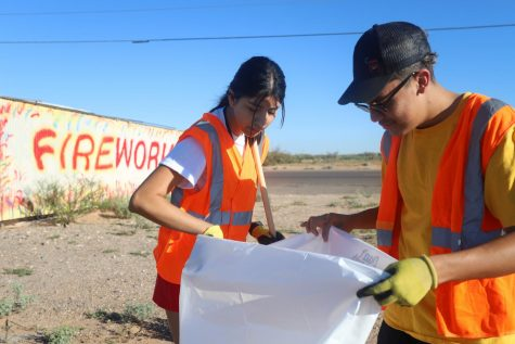 "On Sept. 28, an Adopt-a-Highway cleanup was held at Montana Ave. where senior Aixarret Hernandez helped pick up litter build-up. Aixarret has been able to be a part of It's Your World and many other projects to help out the community through her CAS projects.. ""For CAS I started two of my own projects, Equal Life and Love for Elders, and I'm a part of two others, which are Cleats for Kidsand It's Your World."""