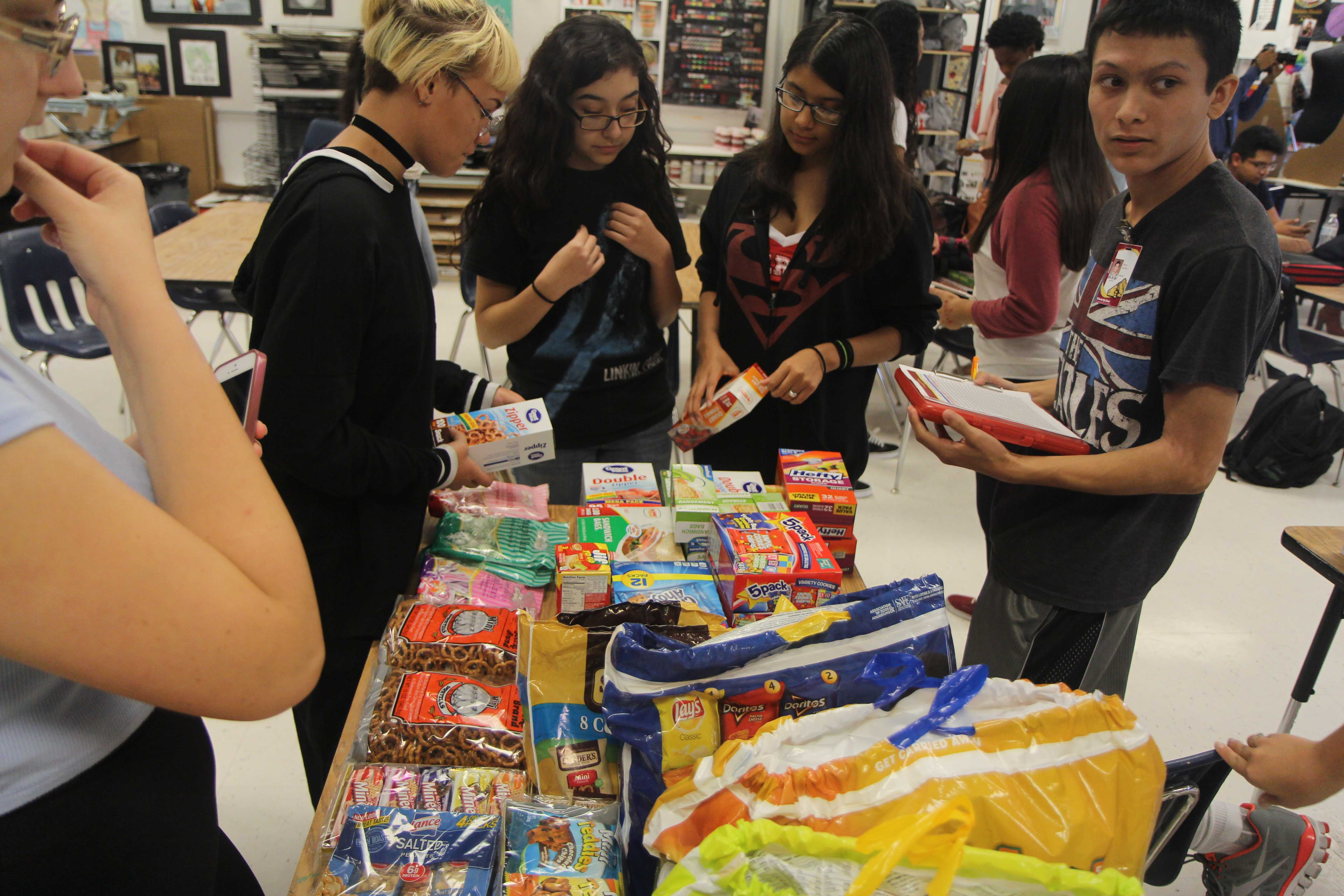 TFCU delivers supplies to 'Your World' project