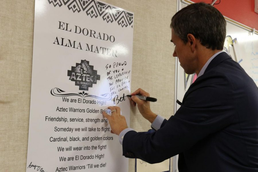 Former congressman and community leader Beto ORourke (D) signs the Alma Mater in the student council room in D-Hall, along with his wife, Amy ORourke.