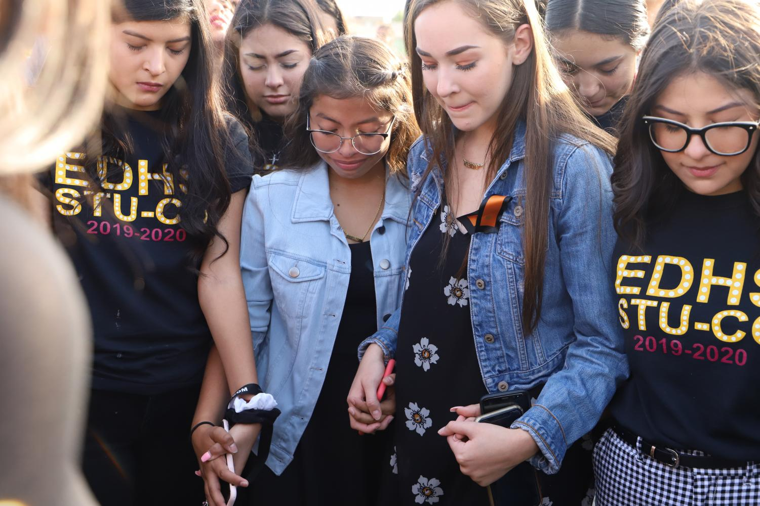 Evany Ramirez, 10, cries with classmates as they say a prayer with presidential candidate Beto O'Rourke (D).