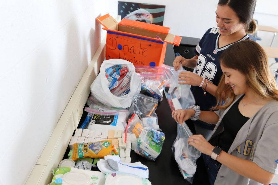 Senior Zoey Renteria packs hygiene items for homeless members of the community during lunch.