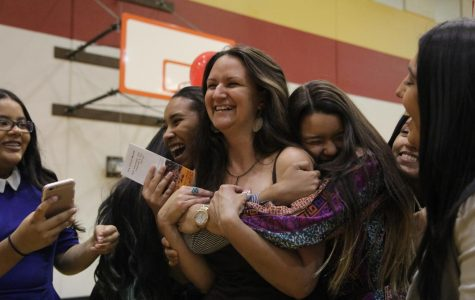 Students run to embrace Candace Printz during the It's Your World organization launch, which was attended by Chelsea Clinton in the fall of 2016.