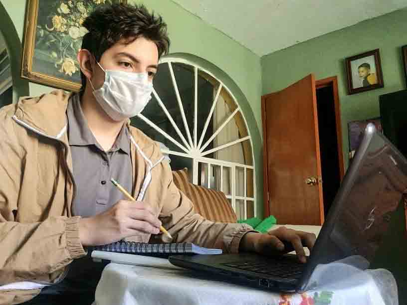 Junior Adrian Garcia attends class from home during the COVID-19 pandemic.