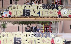 Amaya Flores and Roussel Acosta pose with their families at the Top 15 Drive-Thru Celebration at El Dorado High School on April 28, 2021. Flores and Roussel were both matched to Columbia University through the QuestBridge scholarship program for full rides to the prestigious university.