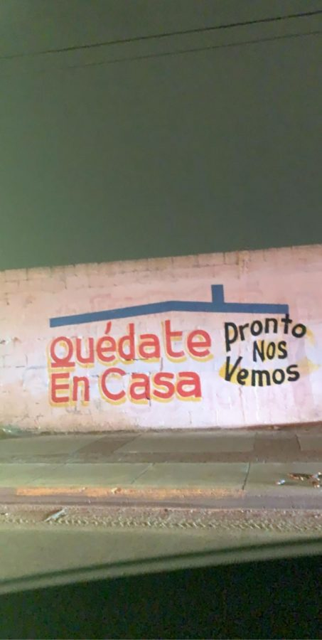 A+student+takes+a+photo+of+a+message+posted+near+the+border+crossing+in+Ciudad+Juarez%2C+to+stay+at+home.+
